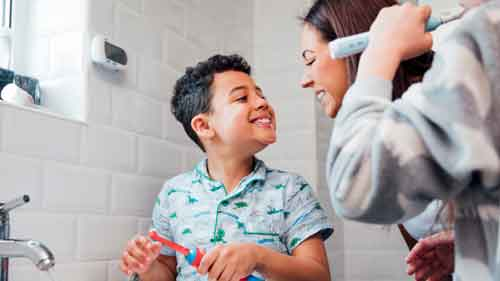 When should a child brush teeth alone?